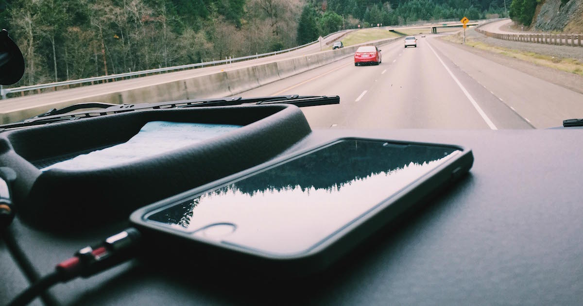 an iphone filled with apps for truckers to use while on the road.