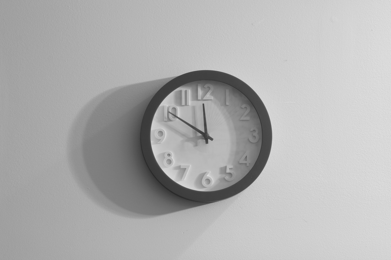 Clock on a wall representing the FMCSAs Hours of Service Extension